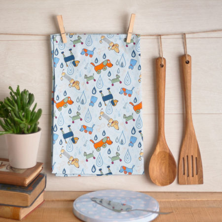 Raining cats and dogs tea towel