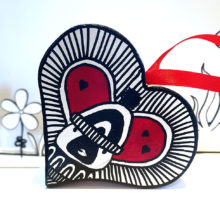 Penguin hat red heart decoration