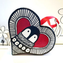 Penguin red heart decoration